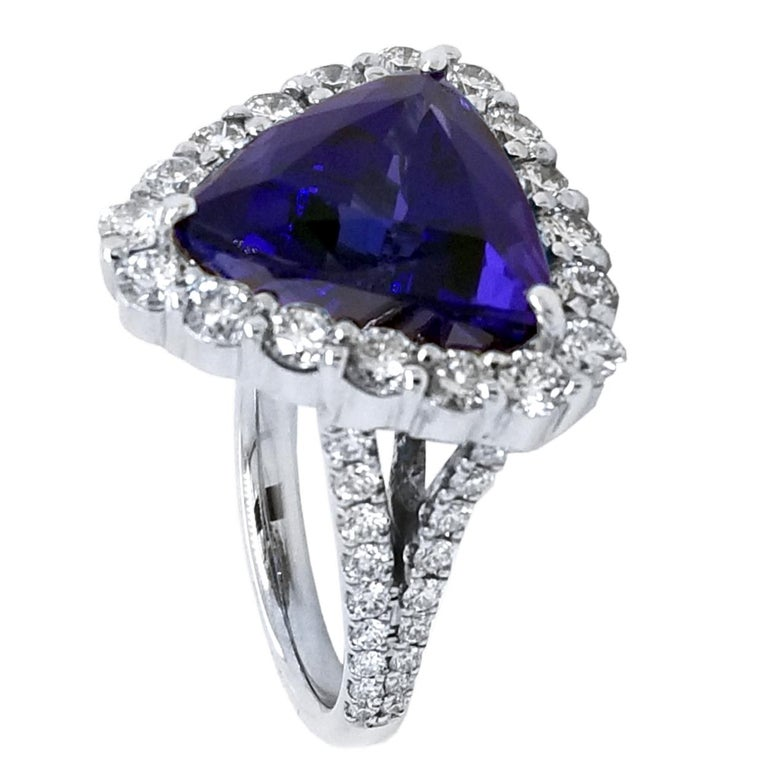 Contemporary GIA 12.40 Carat Trillion Tanzanite Split Shank Pave Set Ring with Halo For Sale