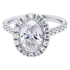 GIA 1.50 Carat G/SI1 Oval shape Diamond 18K Pave Set Engagement Ring with Halo