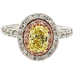 GIA 1.63 Carat Oval Fancy Intense Yellow and Pink Diamonds Ring 18 Karat Gold