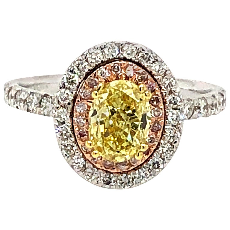 GIA 1.63 Carat Oval Fancy Intense Yellow and Pink Diamonds Ring 18 Karat Gold For Sale