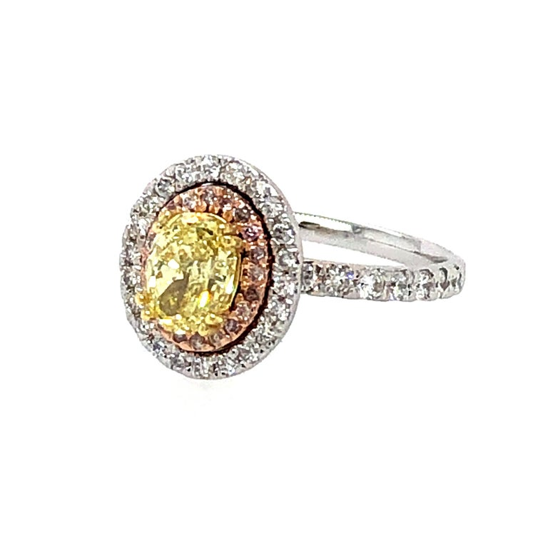 Oval Cut GIA 1.63 Carat Oval Fancy Intense Yellow and Pink Diamonds Ring 18 Karat Gold For Sale