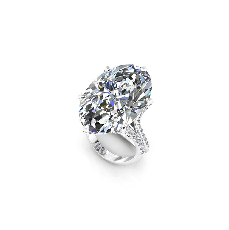 GIA Certified 16.37 carat Oval Diamond, set in a uniquely designed Platinum 950 ring with white diamonds pave' all over the surface of the ring creating an effect of morning dew, for an approximate carat weight of 0.78 carat, conceived with the best