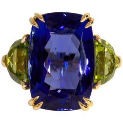 GIA 17.23ct Deep Blue Violet Cushion Tanzanite Peridot and Diamond Trilogy Ring