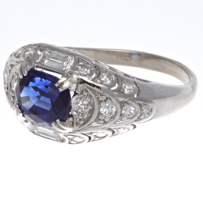 Modern GIA 1.84 carat Madagascar heated sapphire diamond platinum three stone ring. Accented by two trillion cut diamonds weighing approximately 0.41 carats, H-I color, VS clarity. Circa 2000s. The ring is crafted in platinum, size 6 1/2 and may be