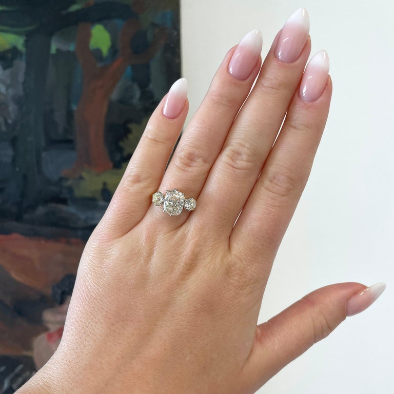 You'll love this exquisite 3-stone diamond ring. It's hard to take your eyes of this glorious Antique Cushion 18k Gold Three Stone Engagement Ring; and why would you want to.  The center stone is GIA certified 2.08 cushion cut diamond, K color, VS1