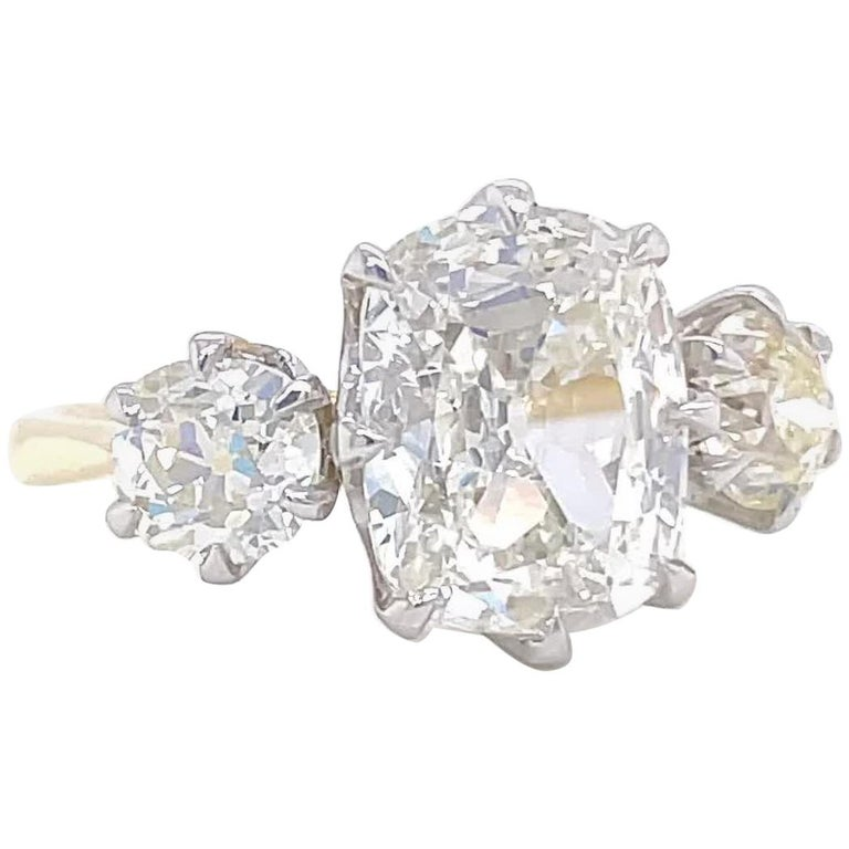 GIA 2.08 Carat Antique Cushion Cut Diamond 18k Gold Three Stone Engagement Ring For Sale