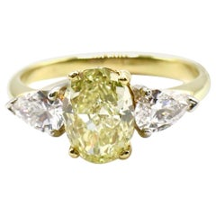 GIA 2.10 Carat Oval Natural Fancy Light Yellow VS1 Diamond Engagement Ring