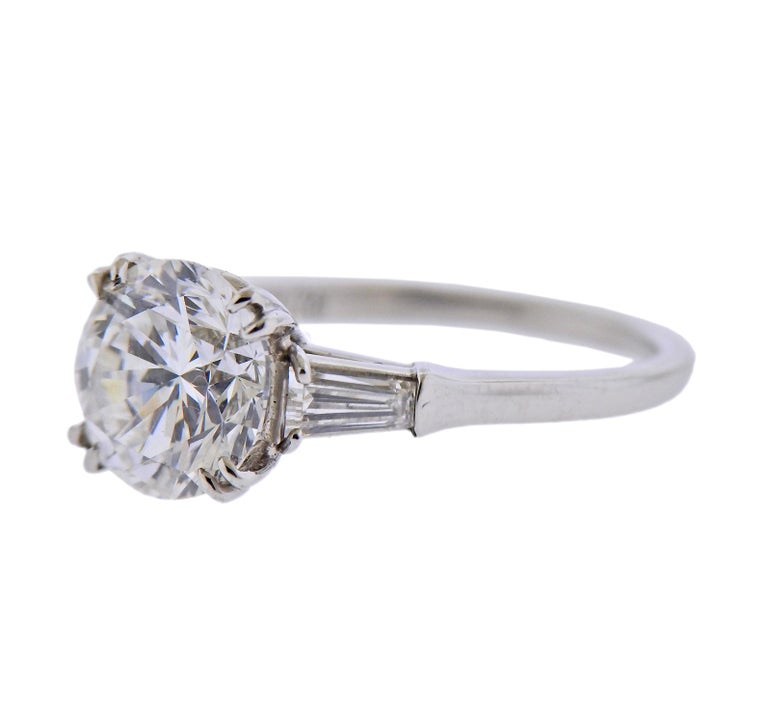 GIA certified 2.23ct F/VS1 diamond, set in Harry Winston platinum ring, with two side tapered baguettes. Ring size - 5.25. Marked: Platinum, 2.23, Winston. Weight - 4.5 grams.