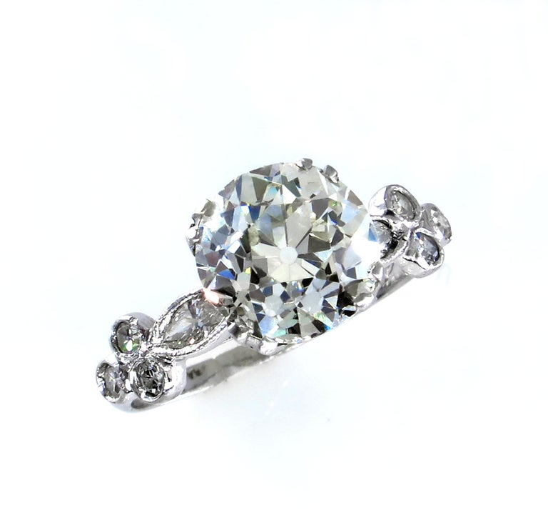 This a perfect example of the wonderful  Authentic Late Edwardian Platinum  Ring will make a beautiful UNIQUE Engagement or Anniversary Ring!  A shimmering old European cut diamond forms the centerpiece of this stunning ring. If you are in the