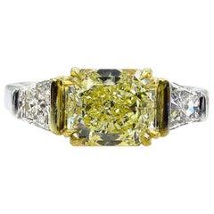 GIA 2.83 Carat Natural Fancy Yellow Radiant 3-Stone Diamond Platinum Ring