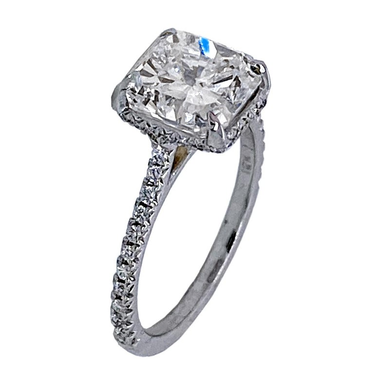 A very fine Square Radiant F/SI1 GIA certified Diamond set in a fine 18k gold French-Pave set Engagement Ring with side halo. Total diamond weight of 0.25 Ct. on the side.   Diamond specs: Center stone: 3.00 Ct GIA Certified F/SI1 Radiant natural