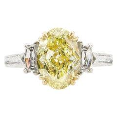 GIA 3.01 Carat Natural Fancy Yellow Oval 3-Stone Diamond Platinum Ring