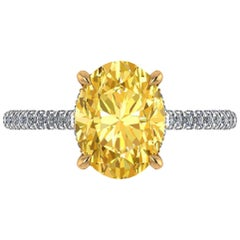GIA 3.06 Carat Oval Vivid Yellow Diamond White Diamonds Pave' Gold and Platinum