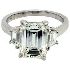 GIA 3.04 Carat I/SI1 Emerald Cut Diamond Platinum 3-Stone Engagement Ring