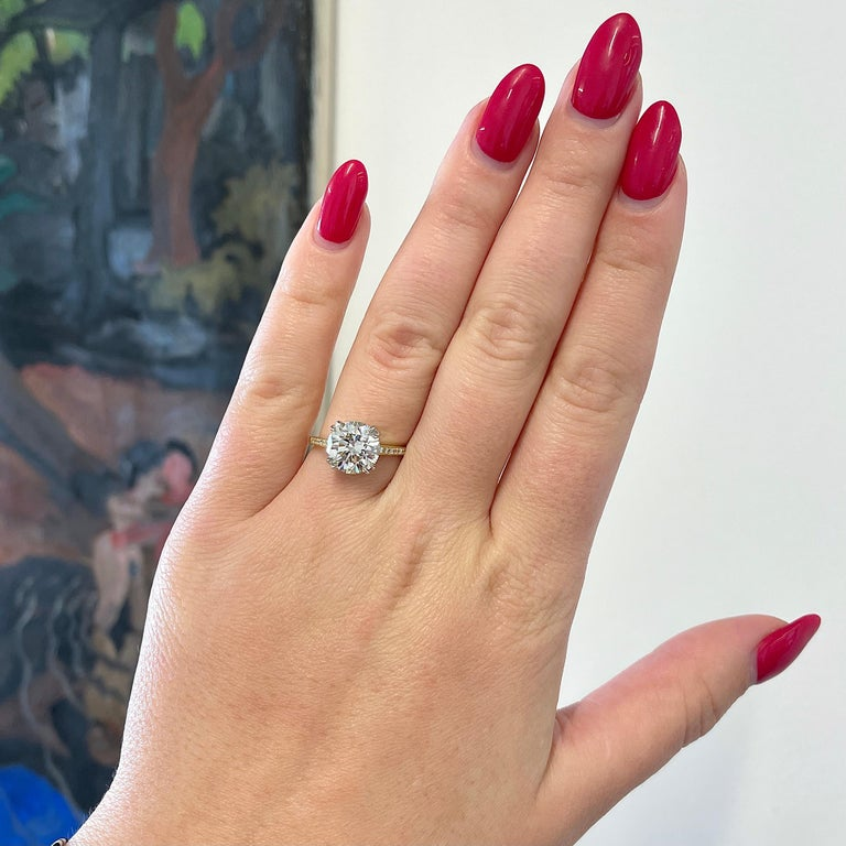 If you like the brilliance of a lively diamond this GIA 3.06 carat Diamond 18k Gold Engagement Ring is perfect for you! This show-stopper ring features a GIA certified Round Brilliant Cut diamond 3.06 carat, J color, VS2 clarity. The ring is adorned