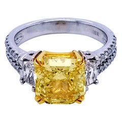 GIA 3.06 Ct Fancy Intense Yellow Radiant Pave Set 18K Ring with 2 Traps on Side