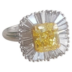 GIA 3.12 Carat Natural Fancy Vivid Yellow Radiant And Baguettes Diamond Ring.