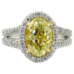 GIA 3.24 Carat Natural Fancy Yellow VS1 Oval Diamond Wedding Platinum Halo Ring