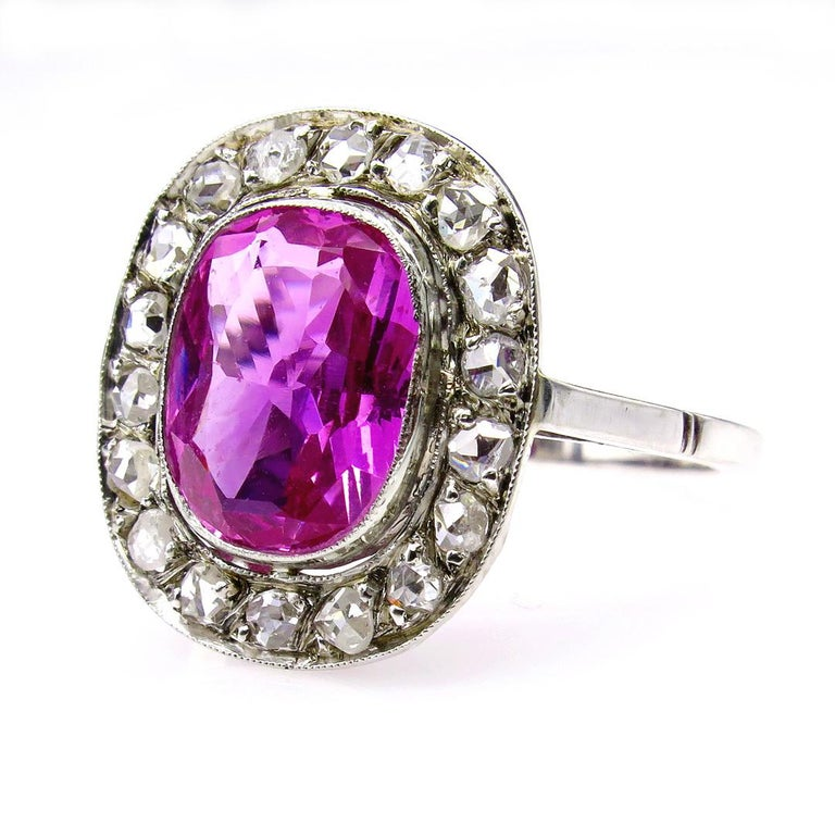 A delightful piece for an avid antique and rare Gem collector (Pink sapphire is the rarest and most valuable of the fancy sapphires)... A truly spectacular and impressive late Edwardian, early Jazz Age jewel.  Pretty in Pink, a 3.12ct Oval cut GIA