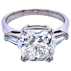 GIA 4.01 Carat H/VS2 Cushion Cut Diamond Platinum 3-Stone Engagement Ring