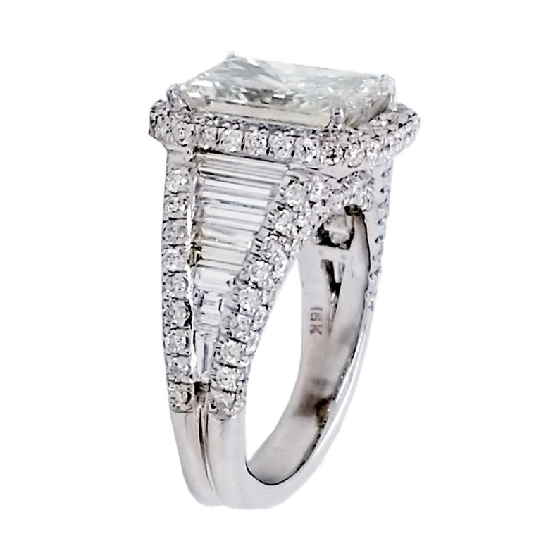 A very fine  Radiant Cut E/SI1 GIA certified center Diamond set in a fine 18k gold baguette & Pave set engagement Ring wit total diamond weight of 2.17 Ct. Diamonds shine from all angles.  Diamond specs: Center stone: 4.02 Ct GIA Certified E/SI1