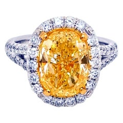 GIA 4.03 Carat Fancy Yellow Oval Diamond French Pave Set 18 Karat Ring with Halo