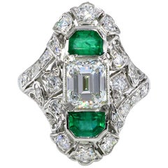 GIA 4.0 Carat Emerald Cut Diamond and Green Emeralds Platinum Art Nouveau Ring