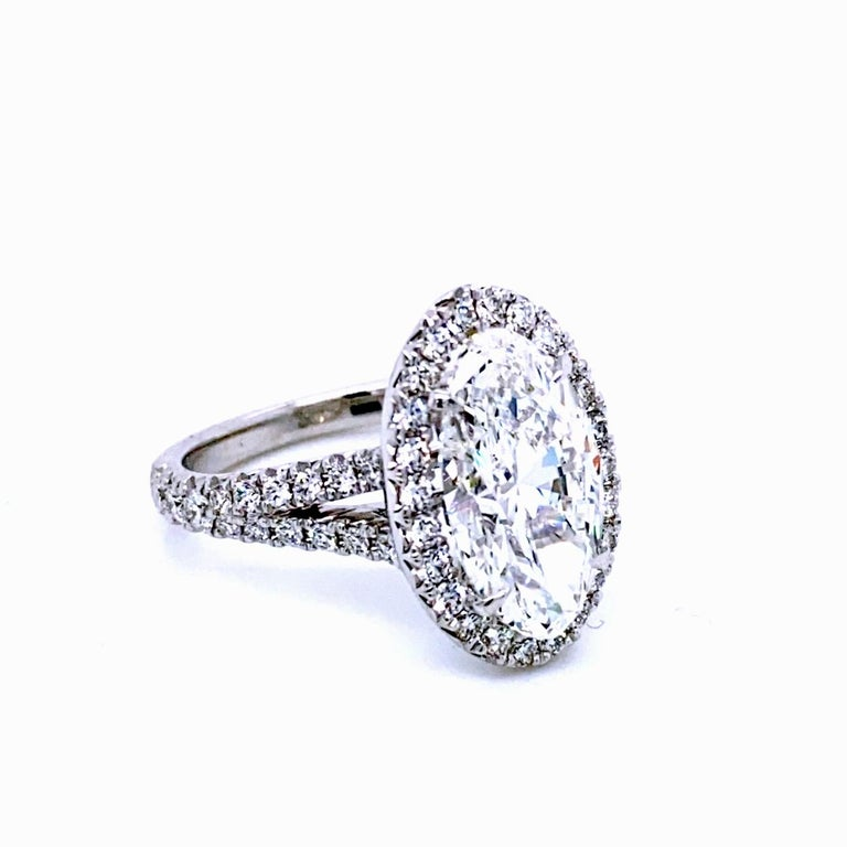 Contemporary GIA 4.10 Carat F/VVS2 Oval Diamond French Pave Set Engagement Ring with Halo For Sale