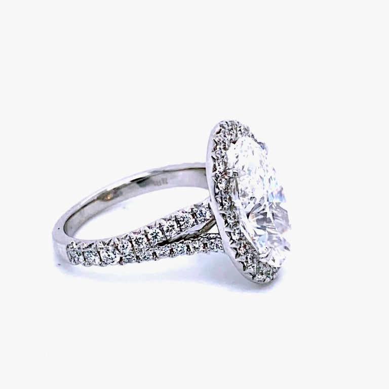 Oval Cut GIA 4.10 Carat F/VVS2 Oval Diamond French Pave Set Engagement Ring with Halo For Sale