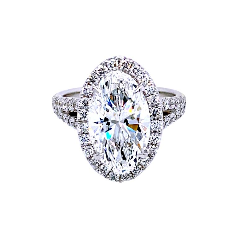 GIA 4.10 Carat F/VVS2 Oval Diamond French Pave Set Engagement Ring with Halo For Sale