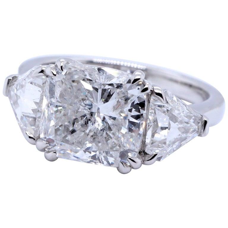 GIA 4.54 Carat Cushion Cut Diamond Three-Stone Platinum Engagement Ring For Sale