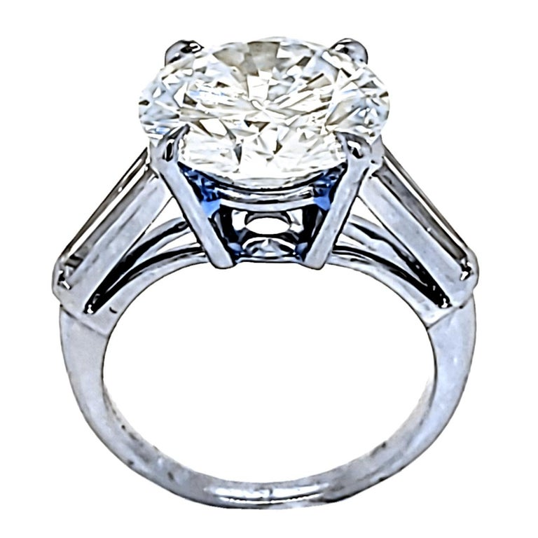 A shiny 4.64 Ct Round Brilliant K/VS1 GIA Certified center Diamond set in a fine Platinum 3 Stone Engagement Ring with two Long Tapered Baguette diamonds on the side. Total diamond weight of 0.40 Ct. on the side.   Center stone: 4.64 Ct GIA