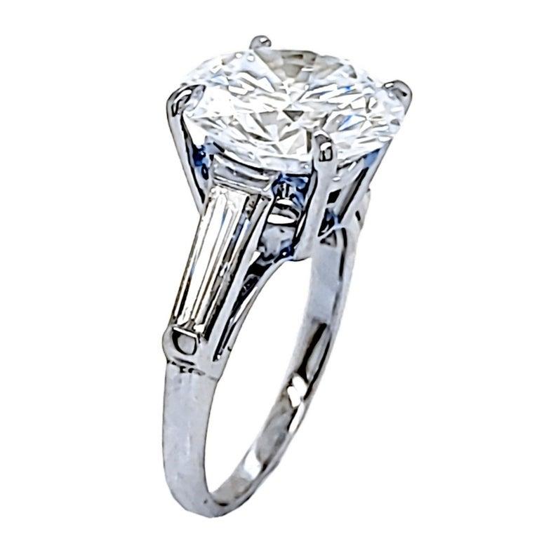 Round Cut GIA 4.64 Carat K/VS1 Round Brilliant Diamond Platinum 3-Stone Engagement Ring For Sale