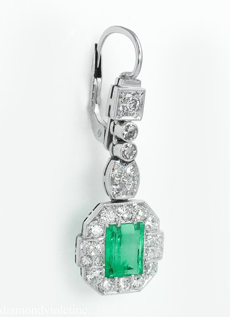 A wonderful Authentic Late Edwardian/ Early Art Deco CIRCA 1915s GIA Certified Green Emerald Diamond Drop Earrings in Platinum (tested). The each Center Stone is Natural Colombian Green Step cut Emerald, estimated total weight is 2.46ct. NO