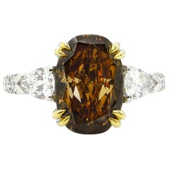 GIA 4.85 Carat Natural Fancy Brown Orange Oval Cut Diamond 3-Stone Platinum Ring