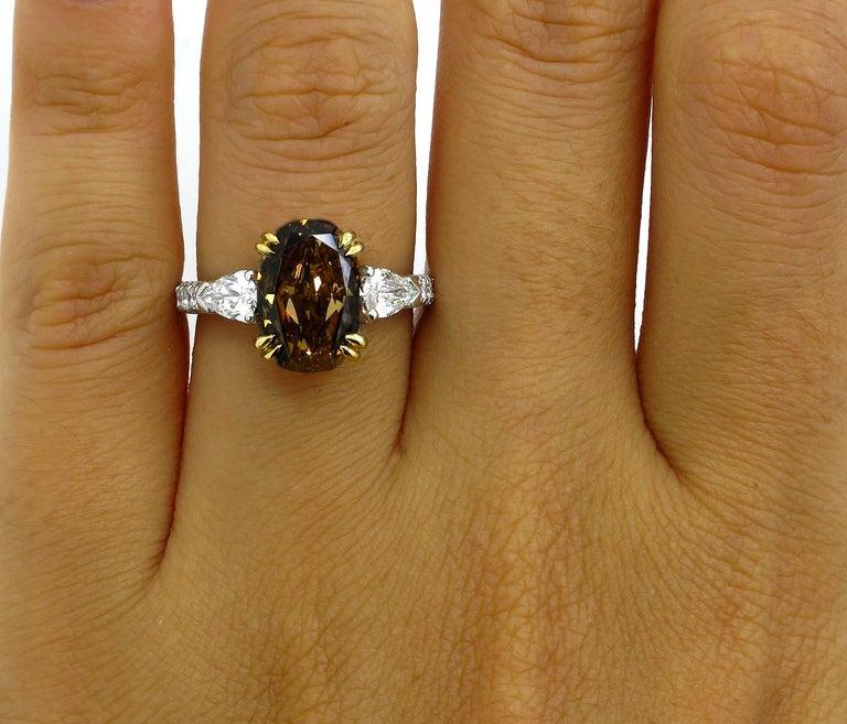 GIA 4.85 Carat Natural Fancy Brown Orange Oval Cut Diamond 3-Stone Platinum Ring For Sale 6