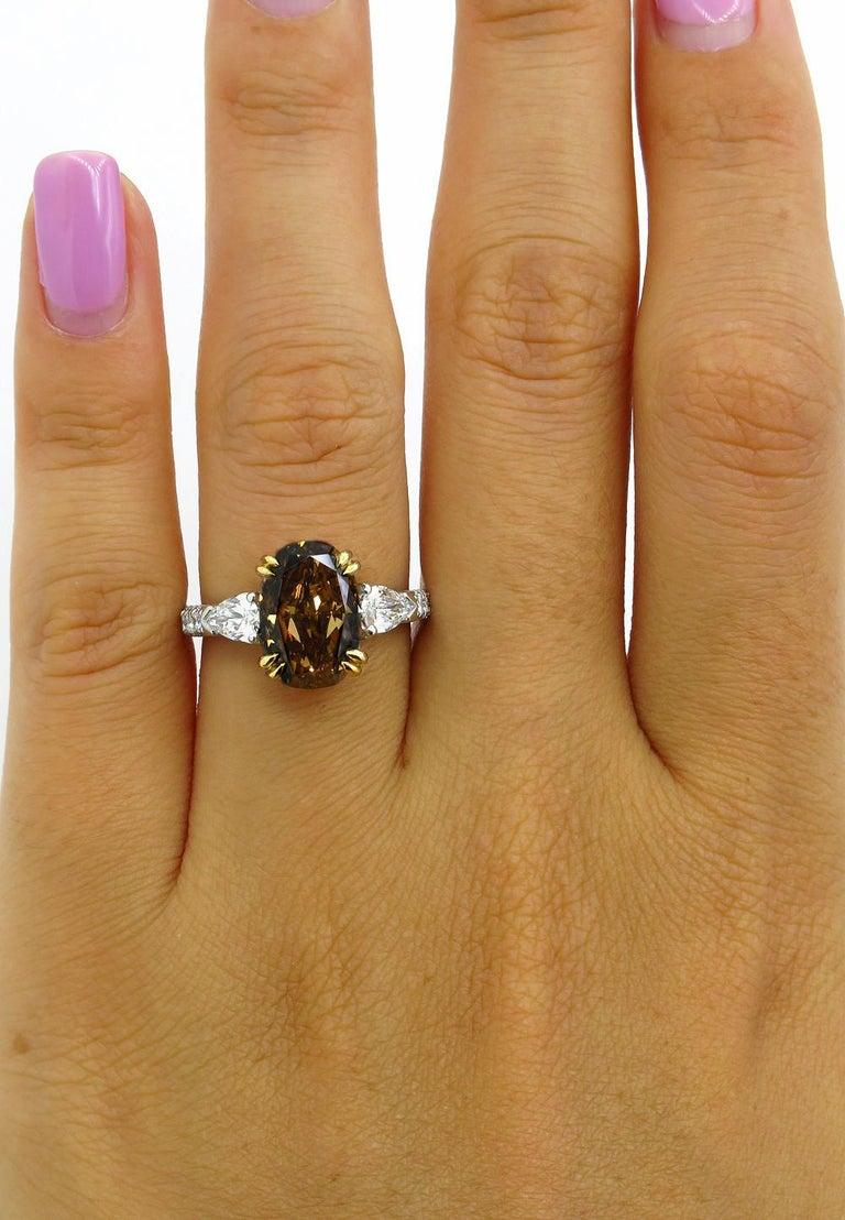 GIA 4.85 Carat Natural Fancy Brown Orange Oval Cut Diamond 3-Stone Platinum Ring For Sale 7