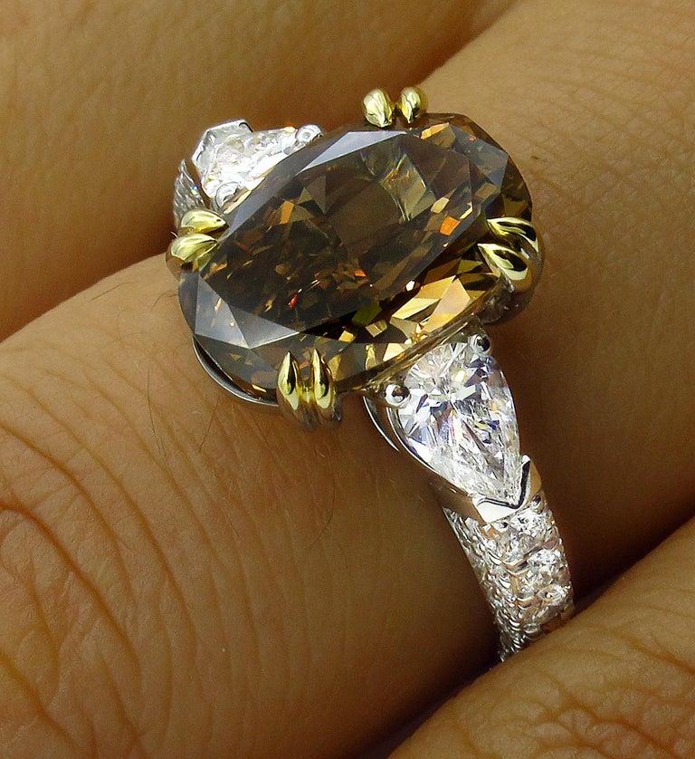 GIA 4.85 Carat Natural Fancy Brown Orange Oval Cut Diamond 3-Stone Platinum Ring For Sale 8