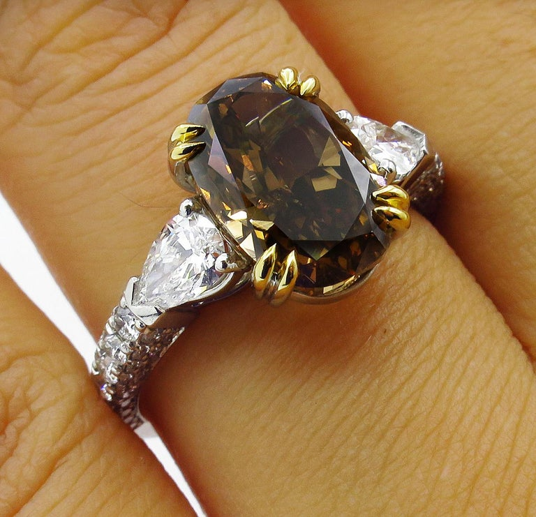 GIA 4.85 Carat Natural Fancy Brown Orange Oval Cut Diamond 3-Stone Platinum Ring For Sale 9