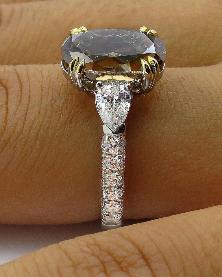 GIA 4.85 Carat Natural Fancy Brown Orange Oval Cut Diamond 3-Stone Platinum Ring For Sale 10