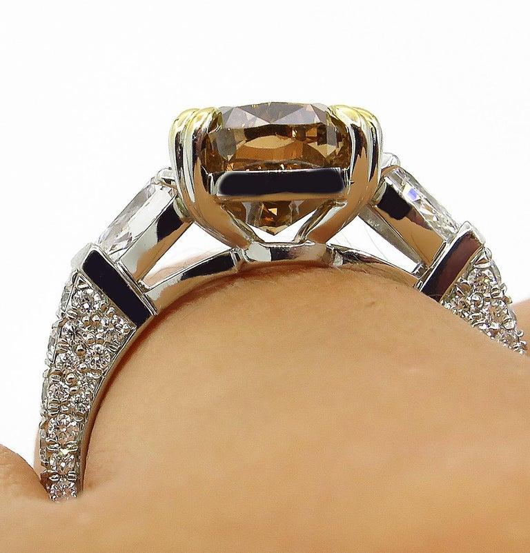 GIA 4.85 Carat Natural Fancy Brown Orange Oval Cut Diamond 3-Stone Platinum Ring For Sale 11