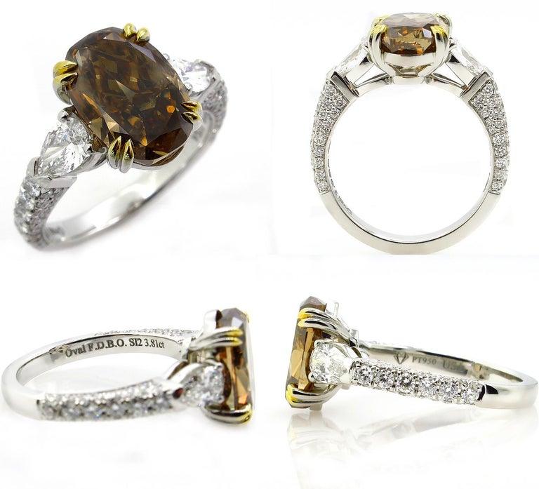 Women's GIA 4.85 Carat Natural Fancy Brown Orange Oval Cut Diamond 3-Stone Platinum Ring For Sale