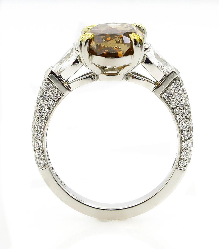 GIA 4.85 Carat Natural Fancy Brown Orange Oval Cut Diamond 3-Stone Platinum Ring For Sale 1