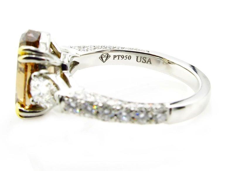 GIA 4.85 Carat Natural Fancy Brown Orange Oval Cut Diamond 3-Stone Platinum Ring For Sale 3