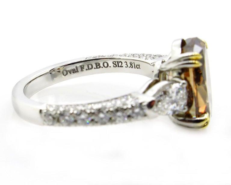 GIA 4.85 Carat Natural Fancy Brown Orange Oval Cut Diamond 3-Stone Platinum Ring For Sale 4