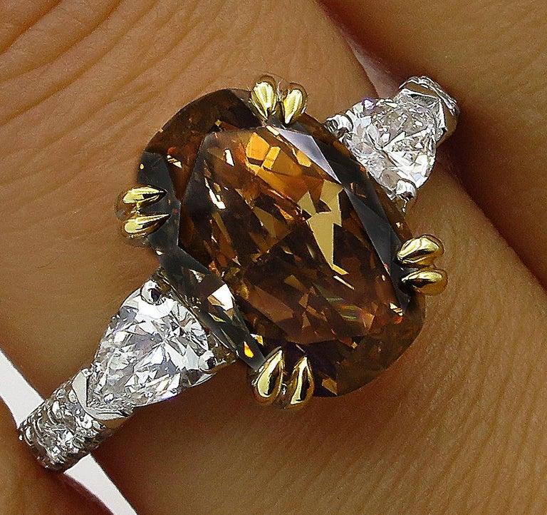 GIA 4.85 Carat Natural Fancy Brown Orange Oval Cut Diamond 3-Stone Platinum Ring For Sale 5