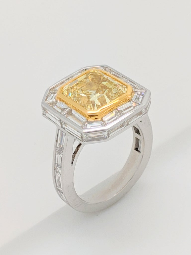 GIA 5.01 Carat Natural Fancy Yellow Emerald Cut Diamond Engagement Ring Platinum For Sale 5