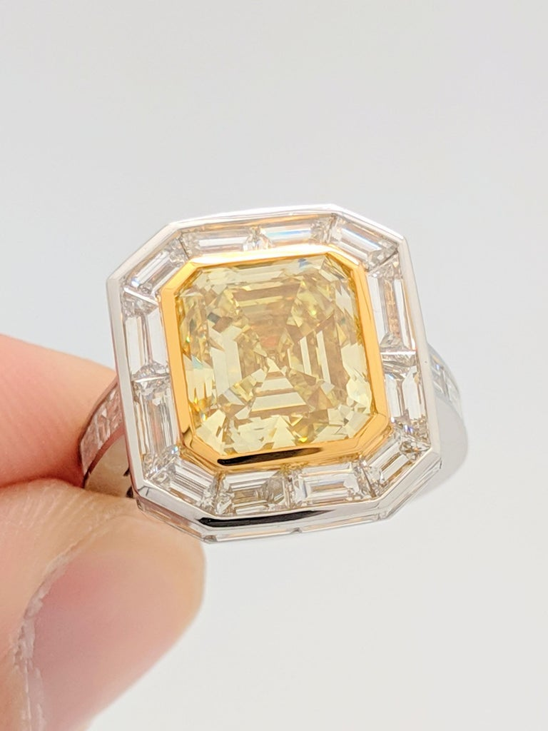 GIA 5.01 Carat Natural Fancy Yellow Emerald Cut Diamond (VS1) in Custom Platinum Setting with Baguettes. 9.51 Total Carats   You are viewing a stunning, one of a kind, natural fancy yellow diamond engagement ring.  This breathtaking ring consist of