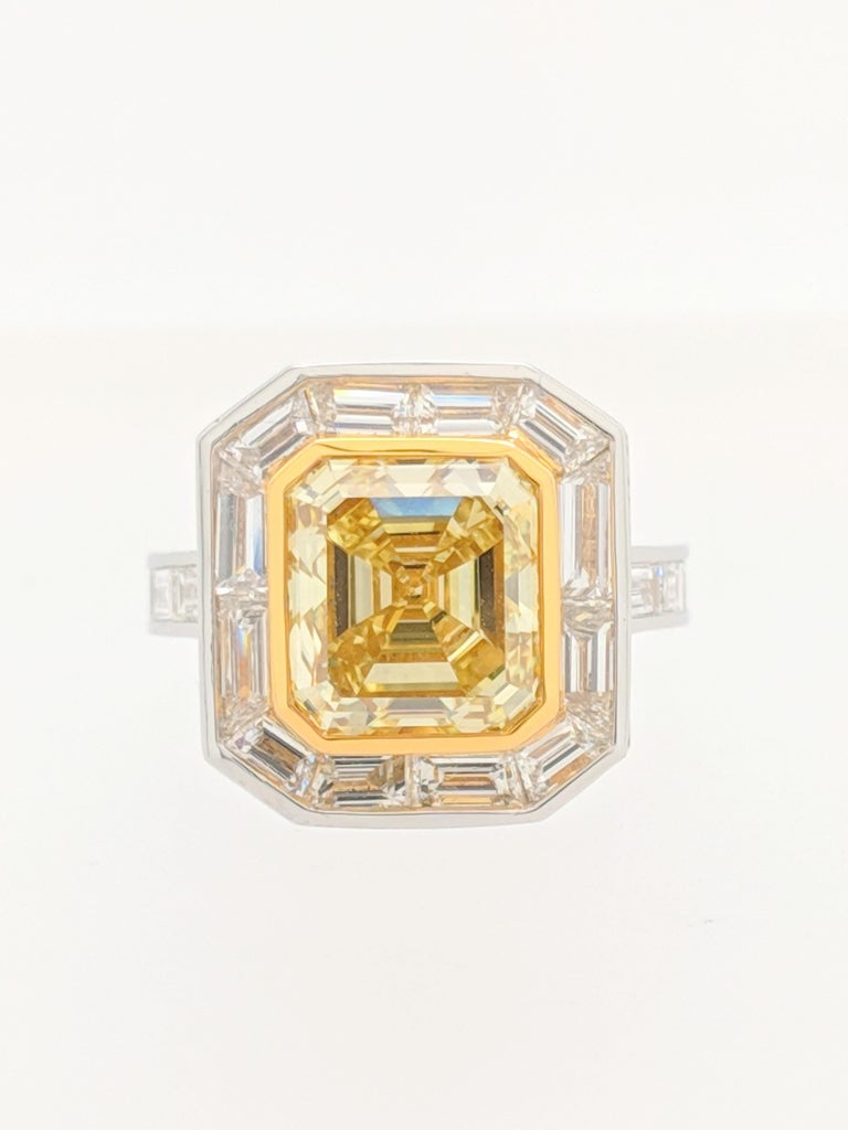 Contemporary GIA 5.01 Carat Natural Fancy Yellow Emerald Cut Diamond Engagement Ring Platinum For Sale