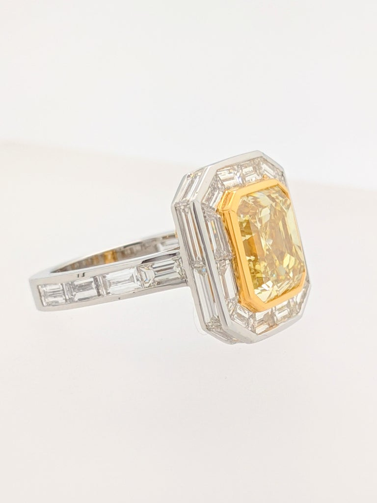 GIA 5.01 Carat Natural Fancy Yellow Emerald Cut Diamond Engagement Ring Platinum In Excellent Condition For Sale In Gainesville, FL